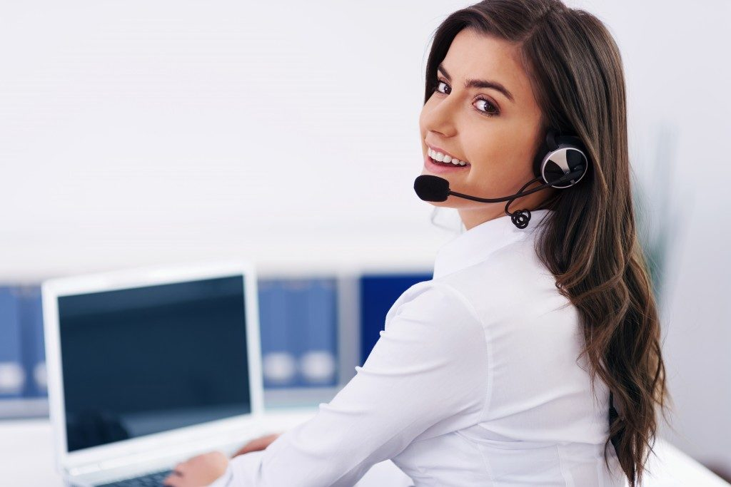 Female operator with headphones on