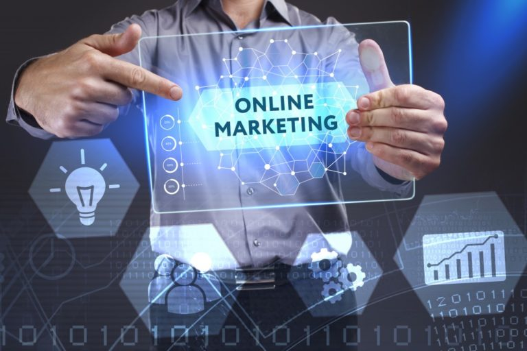 Businessman holding an online marketing sign
