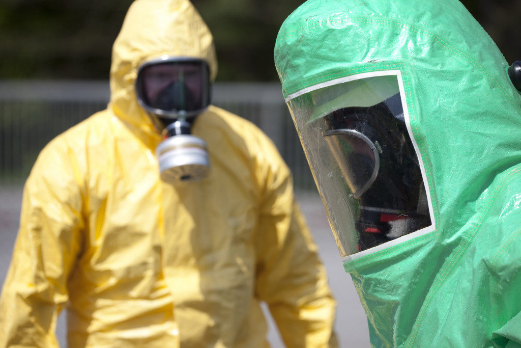 Two men wearing protective gear for pandemic